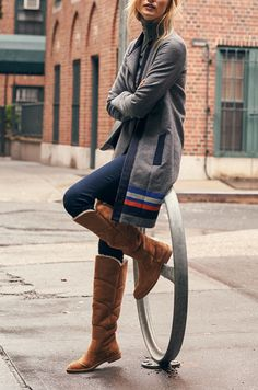Must have these over-the-knee UGG boots for fall! Love how they're paired with skinny jeans and a long, sporty cardigan. Perfect weekend look for running errands or lounging.