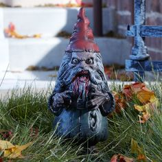 """The perfect scare for your ghostly garden! Travel no further to find a terrifying garden scare! This scary Zombie Garden Gnome is 17"""" high and can be used indoors or out. Plastic"""