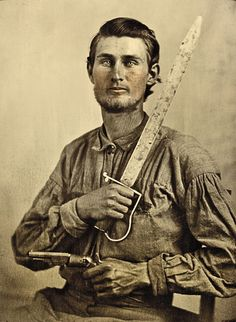 *CONFEDERATE PVT. SIMEON J. CREWS ~ of Company F, 7th Texas Cavalry Regiment, poses with his cut down saber and a revolver. After the news of Gen. Robert E. Lee's surrender, his unit disbanded on May 27, 1865, at Wild Cat Bluff in Texas. Rebels disgruntled by losing the war are believed to have joined John Rapp and notorious gunman Ben Thompson in raiding the treasury in Austin that June. – Courtesy Library of Congress –