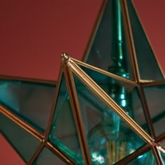 Twinkle Twinkle little....star pendant. Antique brasswork with soft green glass. A very classy centrepiece.