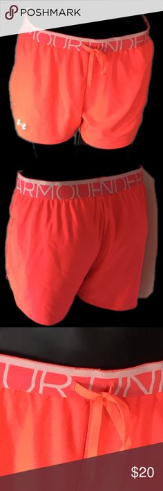 Under Armour Semi Fitted Shorts Size M Neon Orange  From the heat gear line  See materials and care on pictures. See measurements on pictures. Under Armour Shorts