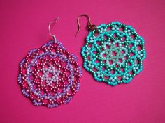 a lovely mix of glass seed beads including galvanized finishes make up intricate mandala discs. they make a subtle statement and would go well with a number of spring and summer outfits for numerous occasions. this circular stitch makes for texturally pleasing pieces, too. these have such a great presence to frame your face and make just a classic boho look i think.  the pink and lavender earrings are suspended from silver plated earring hooks, and the sea green/aqua mix contrast well with…