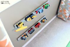 A blogger hung two Grundtal strips on the wall in her boys' bedroom to store their trucks and trains. In addition to being practical, the colorful toys add a fun decor element to the gray wall. See more at Just a Girl and Her Blog »