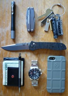 Benchmade••710 + FourSevens••Preon P2 + Leatherman••Juice + Orient••Mako + iPhone 5 w/Magpul Case + Wallet + Leatherman••Brewzer + Leatherman••Style PS + Fenix••E01 + Kingston••16gb Keychain Flash Drives
