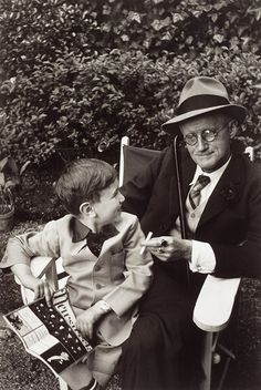 1938 shot of James Joyce with his grandson in Paris. Photograph by Freund