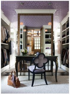 Now this is a closet (dressing room).  I love that there's a writing desk and a mirror the full height of the room.