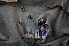 August 2012. Gaza Strip: a Palestinian boy stands in front of his house in the Jabaliya refugee camp