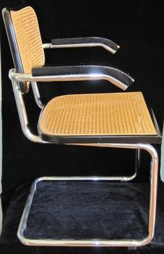 Modern classic pair of Marcel Breuer Cesca arm chairs, with cane back and seat, black lacquered wood and chrome. - $220  This fantastic pair of chairs comes in vintage condition. showing some normal wear on the arms.  Nice, modern, sleak, clean lines and a great fit to all mid century and danish modern teak home decor.  Please note: Given the size of these chairs there is no option for shipping and they will have to be picked up.  clientservices@dejavuantiquesandcollectables.com