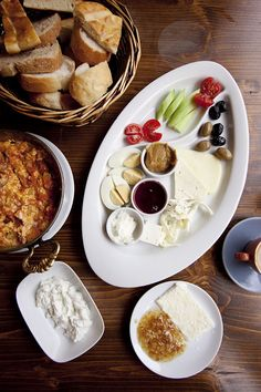 Turkish Breakfast in Istanbul - regional cheeses with tomatoes, cucumbers, olives, crusty bread,  hot tea, sucuklu menemen: fluffy scrabbled eggs with spicy sausage, tomatoes, onions, and peppers, and the indulgent bal kaymak, Turkey's version of clotted cream, adorned with beautifully golden honeycomb. No recipe. This is kind of like what my parents used to do.