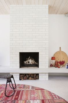 Australian Home Features A Modern Aesthetic With Edwardian Roots ------- gorgeous pickled wood ceiling and painted brick fireplace