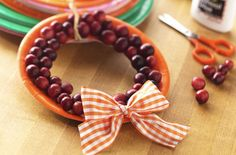 Mini Cranberry Wreaths - great for interdisciplinary unit on cranberries (science: cranberry bogs, plants; SS: where they grow, how Native Americans used them; literature: A Cranberry Thanksgiving; math: estimating berries in a jar, use as counters, patterns on garland w/other items)