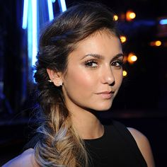The Undone Fishtail: Nina Dobrev's miles of hair get a shoulder-swept style with this rough, messy twist.
