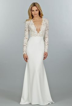 Brides: Tara Keely. Ivory Venise lace and crepe sheath bridal gown, long sleeve bodice with cashmere lining and deep V plunge neckline, slim skirt with chapel train.