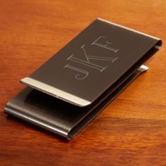 "Gunmetal Personalized Money Clip, from GreatGiftsforMen.com Only $19.95      Double-sided gunmetal money clip      Stylish black metal with a sleek, polished design      Includes a custom monogram for an ultra-sophisticated touch      Measures 2½"" x 1¼"""