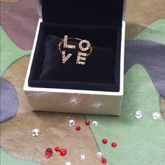 Love Ring Gold  Pave Crystals  Valentine Gift Love Ring Gold Crytals Sparkle Pave brand new. Perfect Valentines Day Gift!  Posh  Jewelry Rings