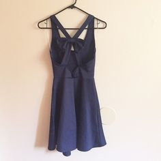 NEW Bow Skater Dress NEW Very pretty navy blue skater dress with a bow on the back! Material is thick and lightweight scuba knit. Very comfortable. Cute for weddings and any party. Size Small :) #skaterdress #navyblue #fitandflare #bow #wedding #partydress #scuba Dresses Wedding