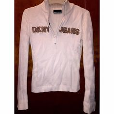 White DKNY sweater White sweater with zipper its in good condition just has a stain on the sleeve that I showed in the last pic I would fold the sleeve because they were too long on me DKNY Sweaters Cowl & Turtlenecks