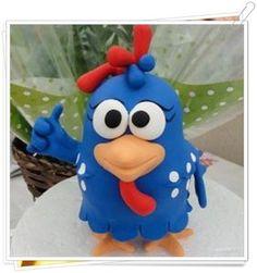 Gosta da galinha pintadinha? Então veja aqui como criar uma linda peça decorativa em biscuit com ess