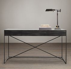 RH's Gramercy Mirrored Desk:The marriage of cast metal frames and antiqued mirror tabletops gives these simple, structural forms their vintage industrial appeal.