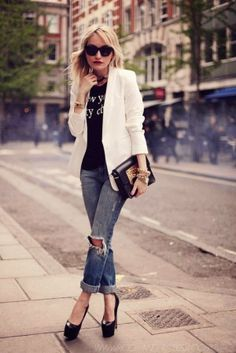 Black blouse with white plan coat and blue denim casual stylish jeans and golden & black leather clutch and shining black high heels pumps