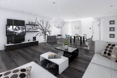10 Black and White Interior Design Inspirations : Awesome Dark Wood Laminate Floor To Furnish Modern Living Room Design Therewith TV Wall Un...