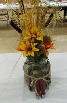shotgun shell wedding decorations -not the biggest fan but I know my bf wouldn't mind incorporating it: