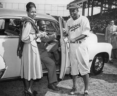 Jackie Robinson of the Brooklyn Dodgers, right, poses with his wife       and Bill (Bojangles) Robinson with a car which was presented to Jackie Robinson from the fans in Sept. 24, 1947