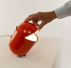 Orange adjustable table lamp, Elmo, designed and produced by Imago DP Milano in 1971.