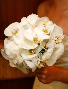 Round; White phalaenopsis orchids with yellow centre. Weddings in Thailand.