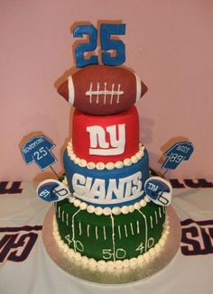 Four tier New York Giants theme birthday cake with football and age on top.JPG