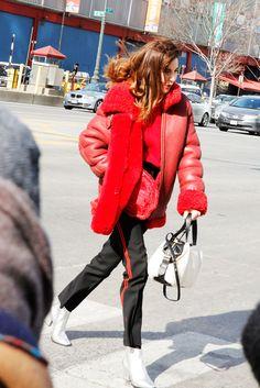 Track pants, amazing coat, silver booties.