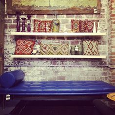 Modern French Blue Leather Lounge by Royal Bohemian at Paris on Ponce With Vintage Moroccan Throw Pillows