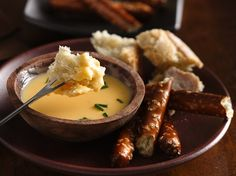 Cheesy Beer Fondue- 1- 18oz can  Progresso™ Recipe Starters™ creamy three cheese cooking sauce, 1/2 Tsp Ground mustard, 1.5 cup shredded cheddar, 1/3 cup beer. Heat sauce n ground mustard to boil. Remove from heat, stir in Cheddar til melted, then stir in beer.