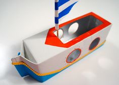 the story of a 'putt putt boat' - MollyMooCrafts - Here's a rainy day craft project for the kids! Make this cute boat out of a milk carton. Boat Projects, Projects For Kids, Diy For Kids, Crafts For Kids, Cardboard Box Crafts, Cardboard Toys, Rainy Day Crafts, Summer Crafts, Milk Carton Crafts