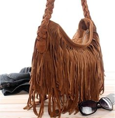 Call me weird but i LOVE fringe!! There's something carefree, fun and sexy about it. Fringe will always make me take a second look. =}
