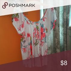 Short sleeve flower blouse Purchased from Aeropostale but never worn. Does not have tags. Can be worn on or off the shoulder. Very loose fit and stretchy, thin material. Aeropostale Tops Blouses