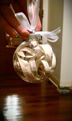 Our thank you gift for the couples.  Christmas ornament ft. their wedding invitation