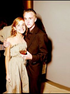 Tom Felton and Emma Watson look how excited she is!!!!!!!