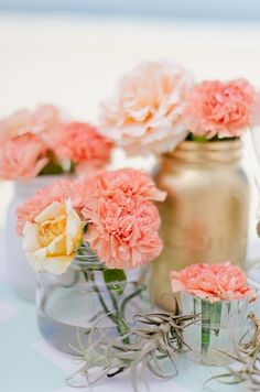 Flower arrangements (mixed gold and white ceramic)  Beautiful Summer Party Ideas www.piccolielfi.it