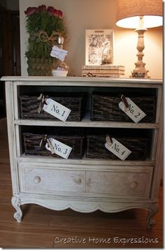 Great bureau that she used baskets instead of drawers or just have open shelving on the top.
