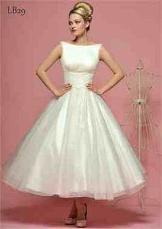 Tea Length Wedding Dress <3 this dress is perfect, not too short but not too long
