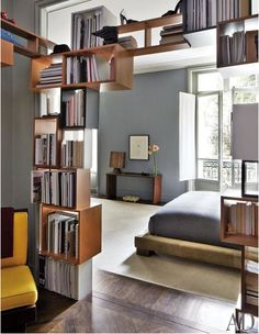 bookshelves, wood floor, grey walls