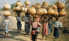Nigerian girls carrying large bottle gourds - image by W Robert Moore, National Geographic