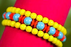 You'll stand out in this bright primary color memory wire bracelet adorned with Czech glass and blue Swarovski crystal pearls. $20 at #SmallestPlanet on #Etsy. Get 15% off your entire purchase with coupon code PIN15.