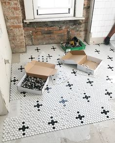With bathrooms, a kitchen, and fireplace surrounds to tackle, we used a LOT of tile while renovating We're super excited… Penny Tile Floors, Bathroom Floor Tiles, Loft Bathroom, Stone Bathroom, White Bathroom, Master Suite, Motif Hexagonal, Hexagon Tiles, Black And White Tiles