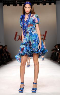 Models walk the runway at the Blue Girl Fashion Show during the Milan Fashion Week.
