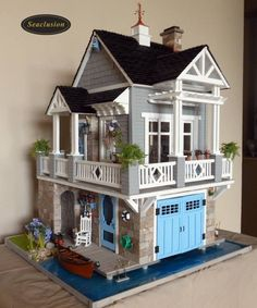 Adorable beach cottage with lower level garage and second story porch