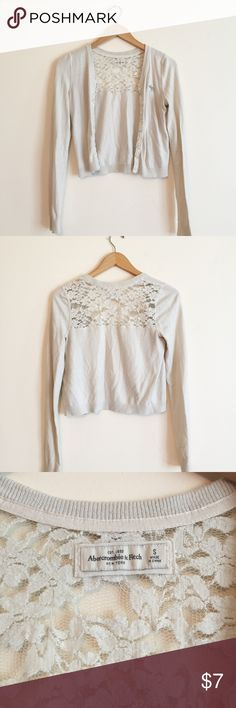 🔵Abercrombie and Fitch Cropped Cardigan SMALL Off white cropped cardigan from Abercrombie and Fitch. Beautiful lace detail. Buttons up. Long sleeve. Barely noticeable stain on sleeve as shown in last pic. Few loose threads shown in second to last pic. Still has plenty of wear left in it. Bundle and save! ✨ Abercrombie & Fitch Sweaters Cardigans