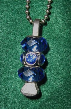 Lucky Horseshoe Nail Pendant with Blue Color by BulletsAntlersEtc, $20.00