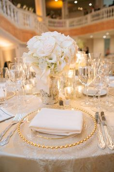 Elegant and classic white & gold wedding at the National Museum for Women in the Arts. Vendors: Well Dunn, Edge Floral. Picture by Eli Turner. See more here: http://www.bellwetherevents.com/